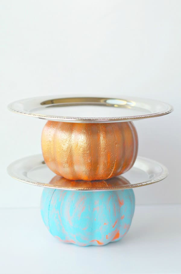 A DIY pumpkin cake stand is one of the cutest fall party decorations