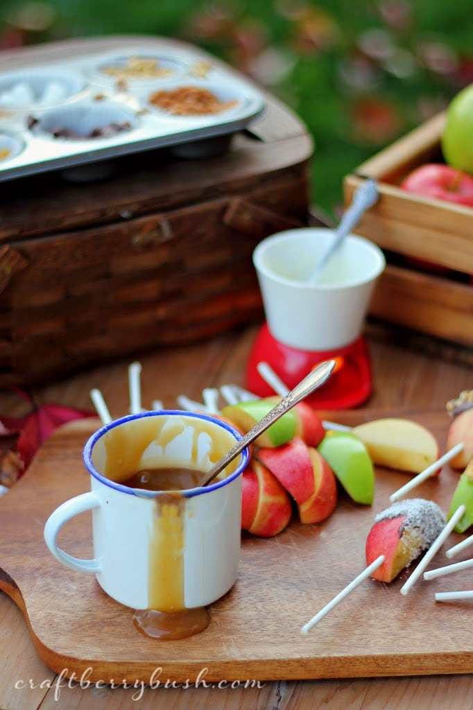 Setting up a caramel apple bar is one of the best fall party ideas