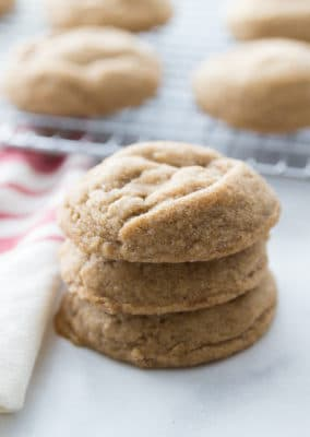 A stack of chewy molasses cookies showing how thick and fluffy they are