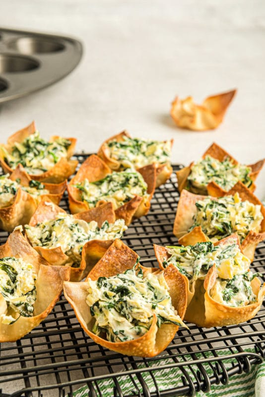 A cooling rack full of spinach dip cups