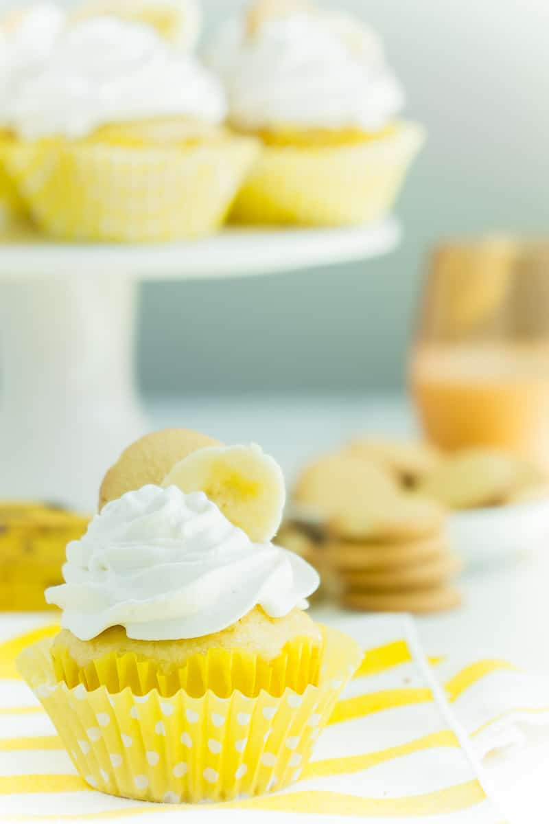 Banana pudding cupcakes on a cake stand with one in the front
