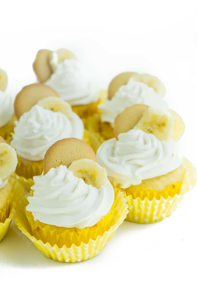 Six banana pudding cupcakes on a white plate