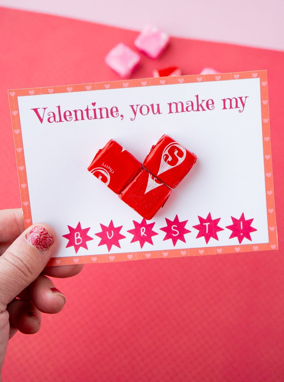 Someone holding Starburst valentines