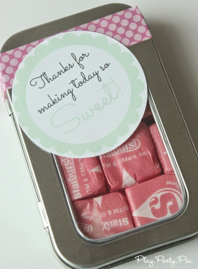 Fill a container with treats and add this free printable tag from playpartypin.com for an easy baby shower idea