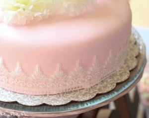 Lace wrapped cake perfect for a bridal shower from playpartyplan.com