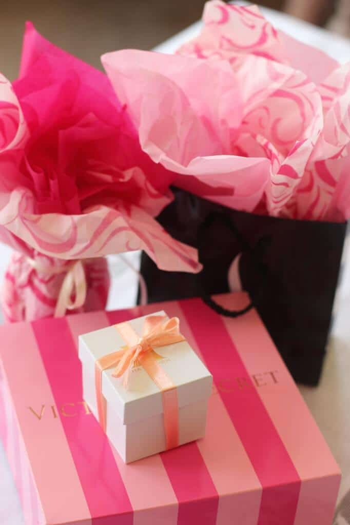 Wrap bridal shower game prizes in ring boxes, Victoria's Secret bag, etc.