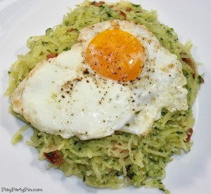 Spaghetti squash with pesto, bacon, and a fried egg from playpartyplan.com #spaghettisquash #healthy #dinner #pasta