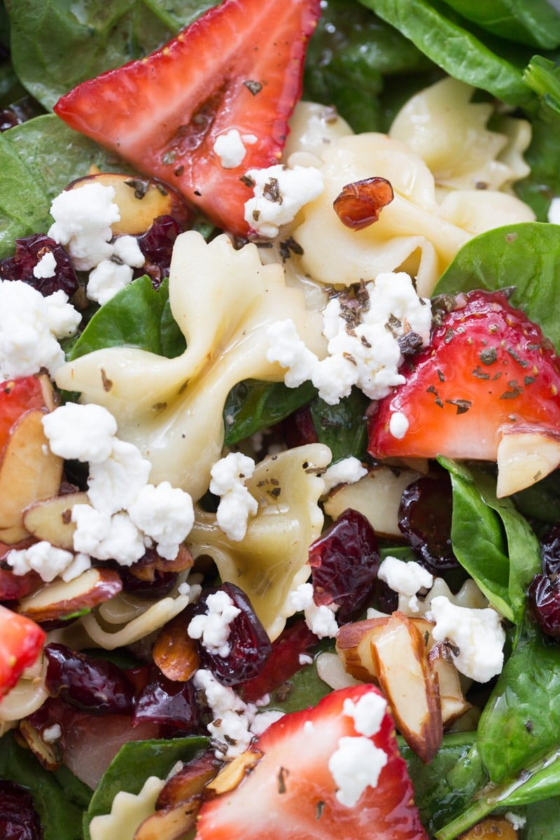 A close-up of strawberry spinach salad