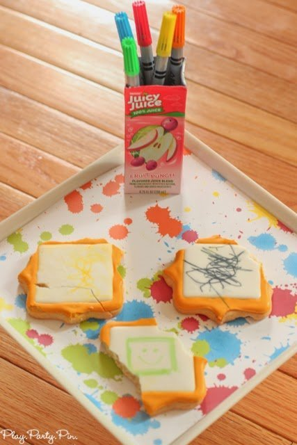 Cut tops off of juice boxes and reuse as art supply holders