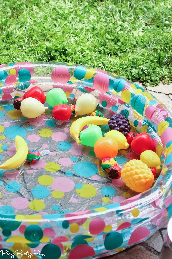 Put fruits (or other colored objects) in a pool and have kids match the color to paint