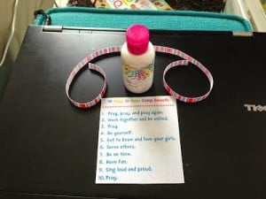 Small bottle of lotion with 10 ways to make girl's camp smooth