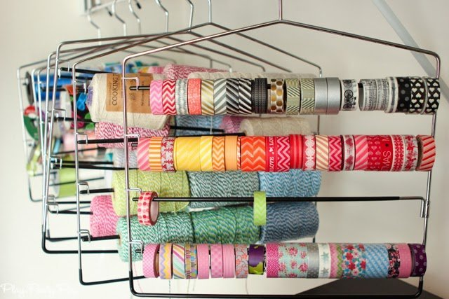 Store washi tape, ribbon, twine, etc. on pants holders, great idea from playpartyplan.com