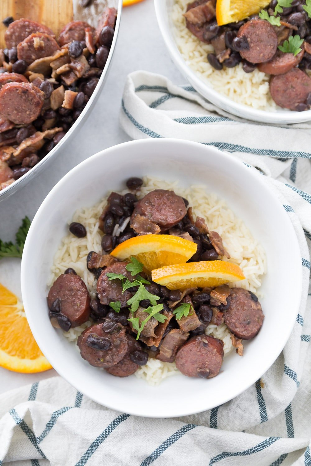 Top down view of two bowls of an easy feijoada recipe
