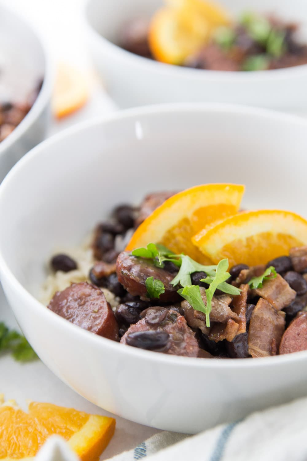 Bowl of feijoada with oranges