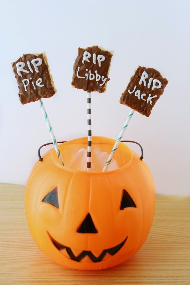 Rice krispy treat tombstones with pumpkin names, love this pumpkin graveyard idea via playpartyplan.com