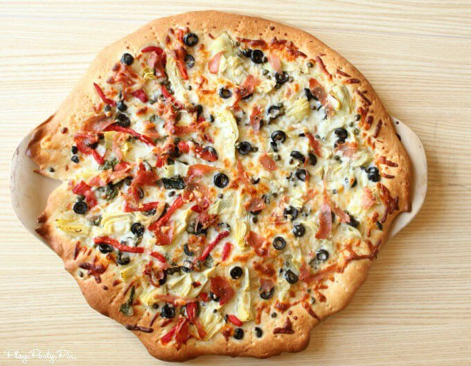 Perfect pizza recipe from playpartypin.com with plenty of veggies, meats, and double cheese