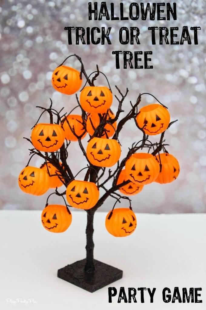 "Pumpkins filled with ""tricks"" and treats. Such a fun idea for a Halloween party game idea or a Halloween countdown calendar for kids, includes free printable ""tricks"" and Halloween activities"