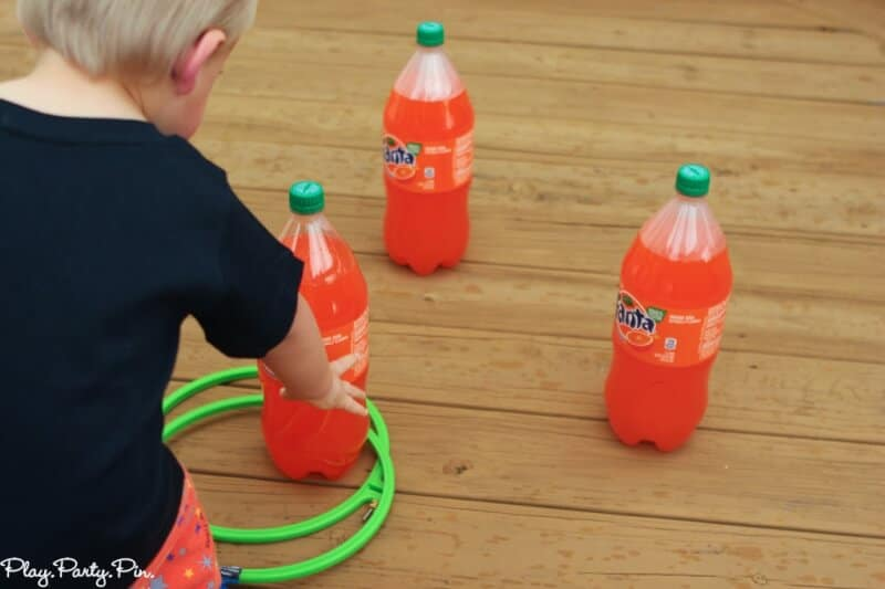 Two-liter ring toss using orange Fanta bottles for fun Halloween party game