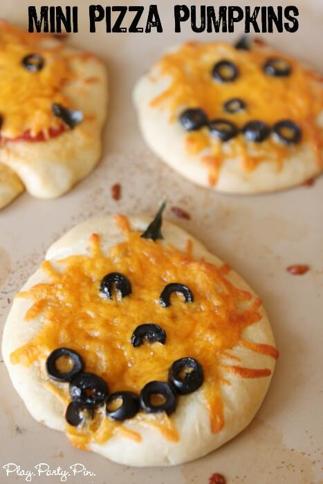 Mini pizza pumpkins are perfect for fall and Halloween party food or to get your kids involved with the cooking