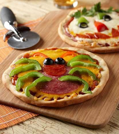 Mini creepy pizzas that are perfect for Halloween
