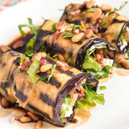 Three eggplant rolls on a plate