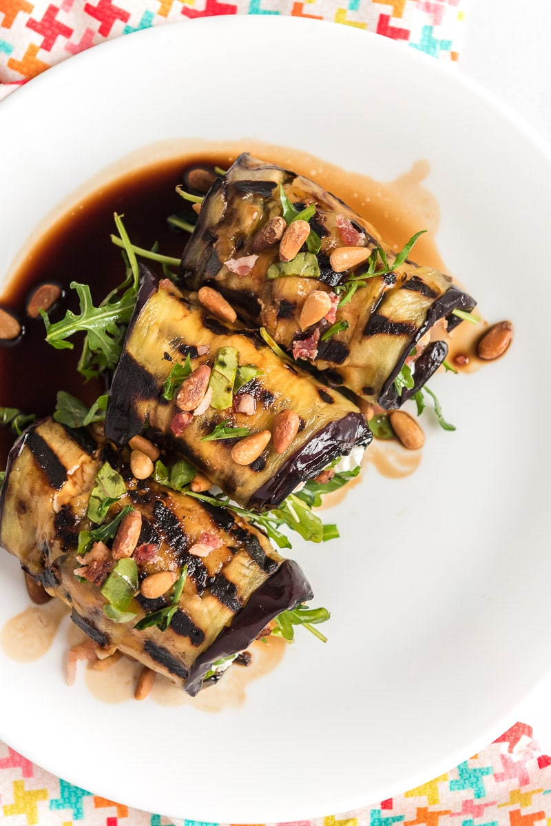 Top down image of eggplant rolls on a plate