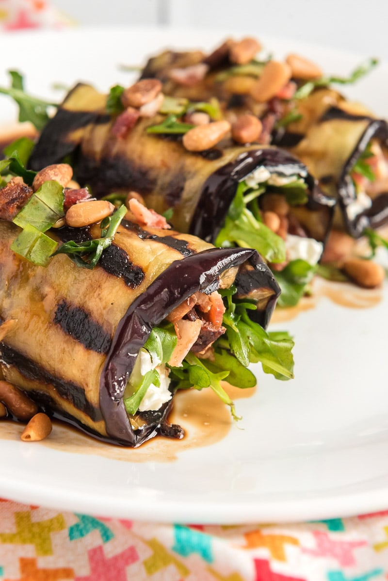 Eggplant rolls topped with pine nuts and goat cheese