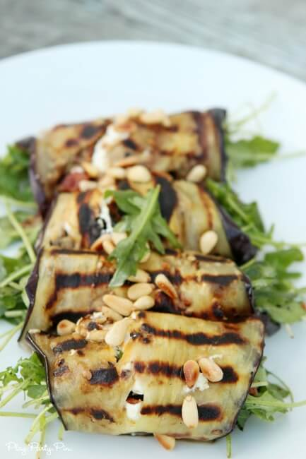 Grilled eggplant rolls with crunchy bacon, pine nuts, and goat cheese