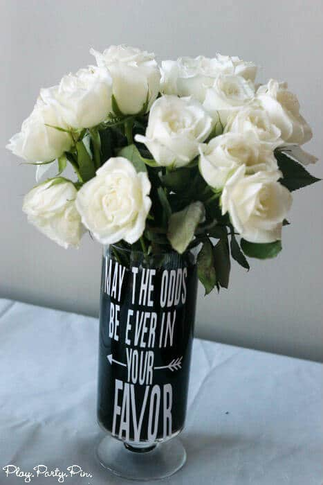 Hunger Games vase with white roses, perfect for a Hunger Games party