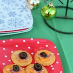 Easy holiday snack idea using Ritz crackers topped with cheese, salami, and olives