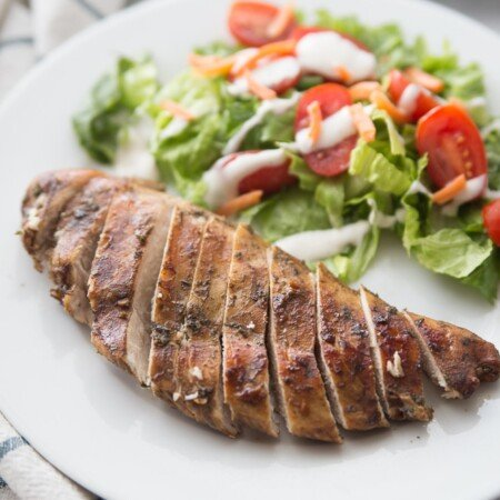 Piece of sliced balsamic chicken with salad