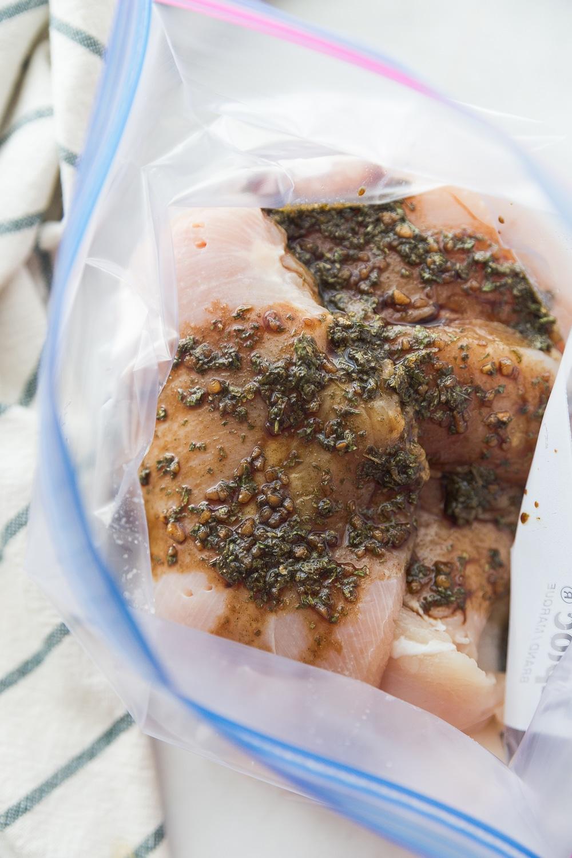 Chicken marinating in a balsamic chicken marinade