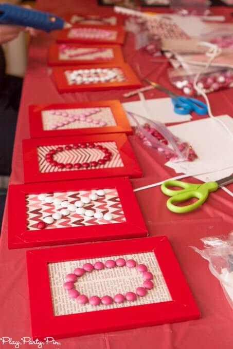 This Valentine's Day word art is such a cute Valentine's day craft idea, and I love the Craft Your Heart Out Valentine's Day party ideas from www.playpartyplan.com