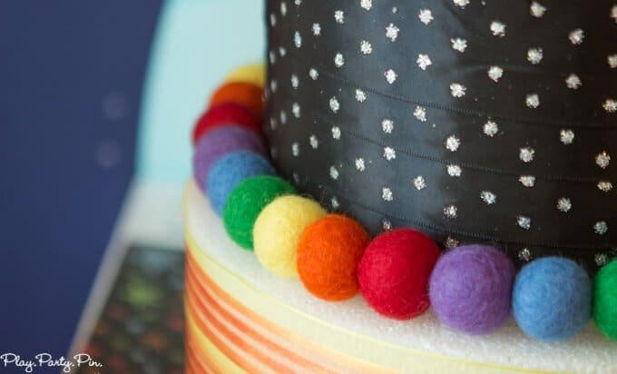 Outer Space party cake, love those planet and rocket cake pop toppers!