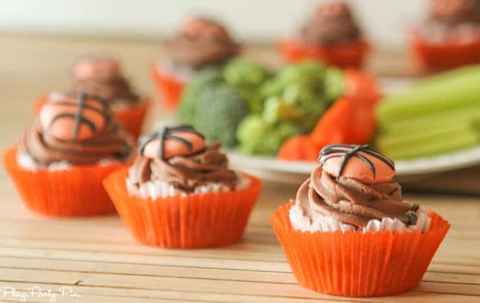 Chocolate Coke cupcakes with a chocolate buttercream and fondant basketballs on top