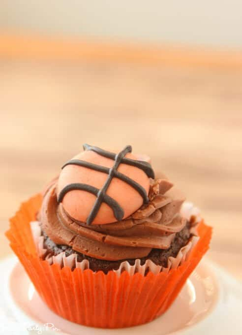 Chocolate Coke cupcakes with a chocolate buttercream and fondant basketballs on topChocolate Coke cupcakes with a chocolate buttercream and fondant basketballs on top