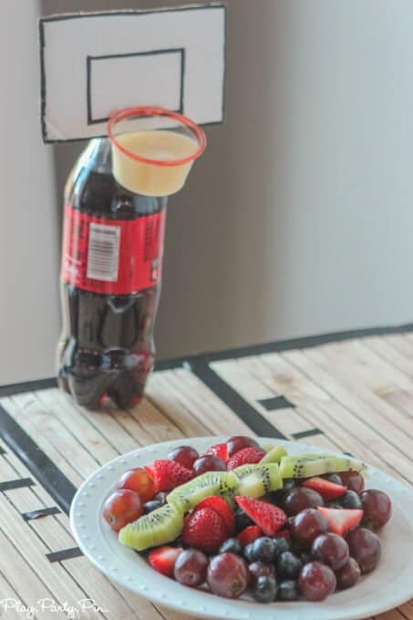 "How awesome is this basketball party, love the cute Coke bottle basketball hoops with fruit dip for ""dunking"" your fruit!"