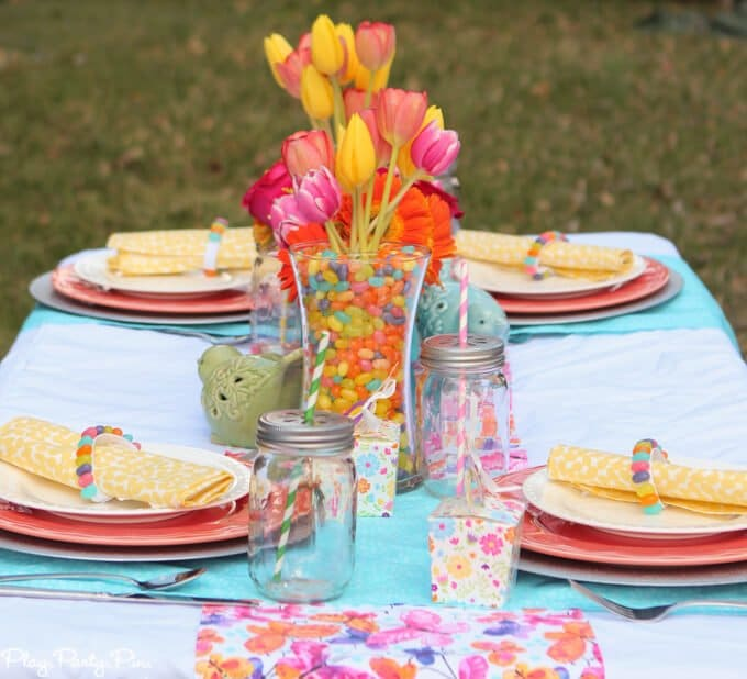 Gorgeous spring tablescape ideas, love the fabrics and jelly bean vases and napkin rings