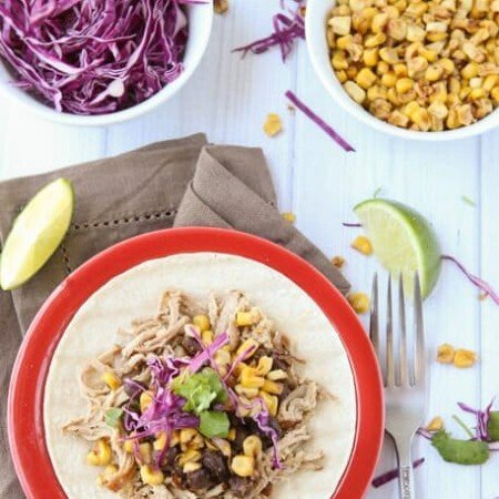 The most amazing pork taco recipe with a crockpot shredded pork and honey citrus cabbage