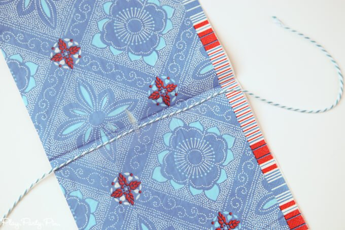 Such a fun idea to make a red, white, and blue garland from paper napkins!