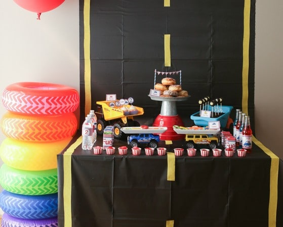 What a cute party table setup for a things that go party or pop a wheelie party, love the idea of creating a road on the table!
