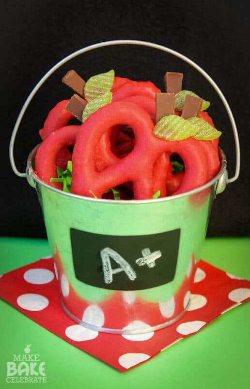 Red pretzels in a green bucket with an A+ sign