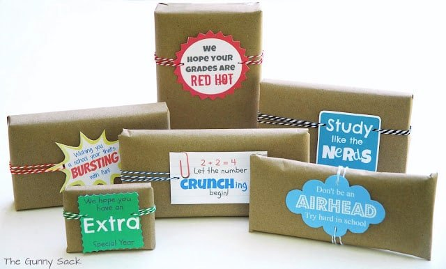 Gifts wrapped in brown kraft paper with tags