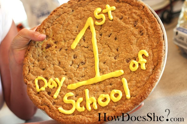 large cookie with 1st day of school in yellow frosting