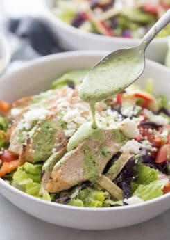 Pouring dressing on southwestern chicken salad