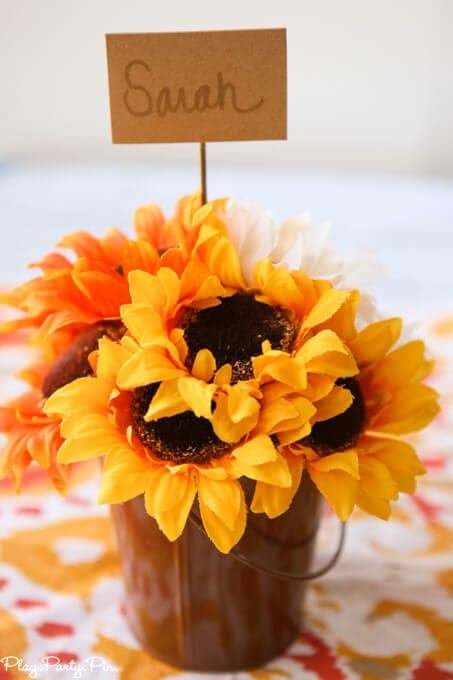 Make these easy fall place cards in just a few minutes with fall colored flowers and foam!