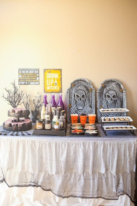Love this dig your own graveyard dessert bar idea, perfect way to let your guests make their own creative Halloween desserts! And how cute are those chocolate covered tombstones!