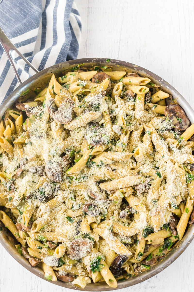 Cheese added to spinach and artichoke pasta