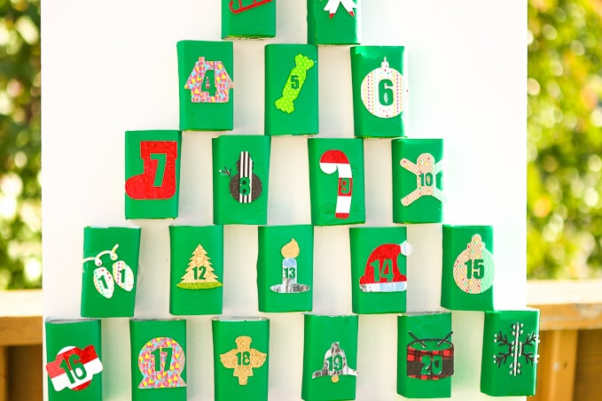 Love DIY crafts? This Christmas advent calendar made with upcycle juice boxes is one of the cutest Christmas ideas I've seen! So simple to DIY and even better, it can even double as Christmas decorations if you're lazy like me! And seriously how cute is that snowflake!