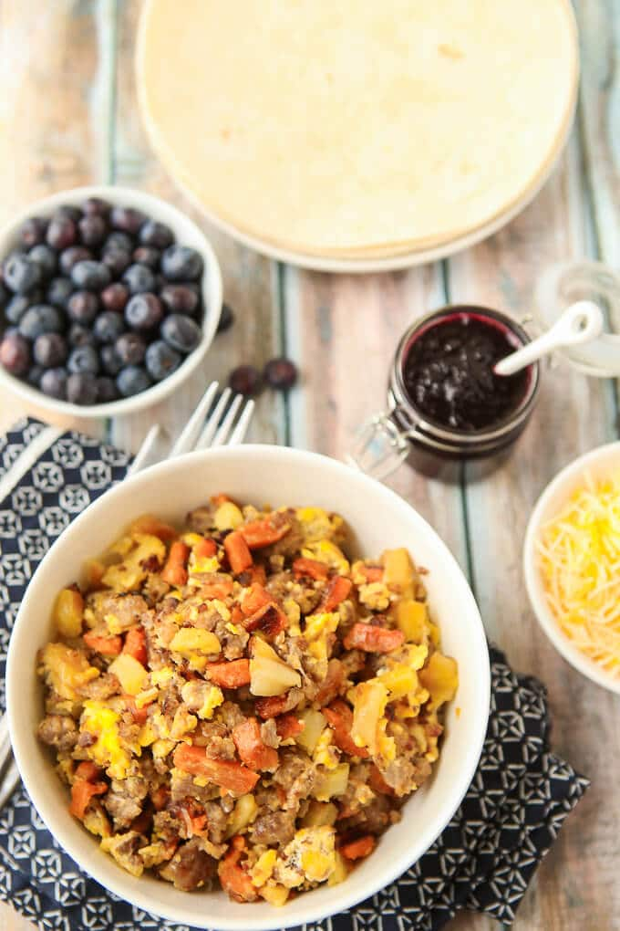 This maple breakfast burrito recipe looks amazing! And I could eat the blueberry compote with breakfast every day. Breakfast burritos are one of the easiest breakfast recipes if you like make ahead food and if you skip the tortilla even make a great gluten free meal. And I love that the recipe uses half regular potato and half sweet potato, I'm definitely trying that!